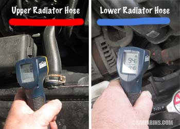 Mechanic measures radiator hose temperature with an infrared thermometer